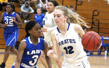 The Fernandina Beach High School boys and girls basketball teams played at home Friday night to celebrate winter homecoming. Lady Pirate Riley Webber in action against Trinity Christian. BETH JONES/NEWS-LEADER