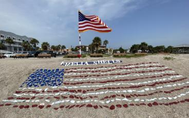 A flag made of seashells adorns Main Beach. PAT FOSTER-TURLEY/FOR THE NEWS-LEADER