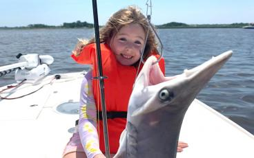Grace Roberts, right, is all smiles after catching this bonnethead shark. SPECIAL
