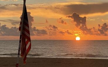 A flag flies on Main Beach at dawn after Labor Day weekend. PAT FOSTER-TURLEY/FOR THE NEWS-LEADER