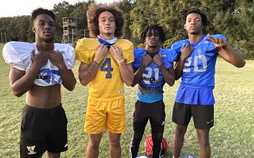 Pirates Khamari Barksdale, Cam Miller, Sincere Rogers and Josiah Rauls, from left, will be in action tonight as FBHS heads into its first appearance in the second round of the playoffs. The Pirates host Bolles at 7:30 p.m. BETH JONES/NEWS-LEADER