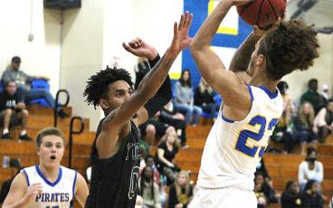 The Fernandina Beach High School basketball teams hosted Yulee Saturday night. The home team won the girls and varsity boys games. Yulee's Zach Drawdy goes one-on-one with FBHS's Cam Miller. BETH JONES/NEWS-LEADER