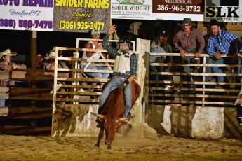 Conner Bennett takes his turn as a junior bull rider during a rodeo recently. The Hilliard teen began bull riding a couple months ago. He dreams of becoming a professional bull rider one day. Photo courtesy of Mark Belton