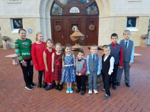 Barnabas continues to build partnerships with churches, civic groups and businesses in Nassau County to serve people in need during COVID-19. Jodie and her husband's 10 adopted children are pictured.