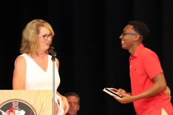 Principal Tammy Johnson presents Tre Rush with the Principal's Leadership Award.