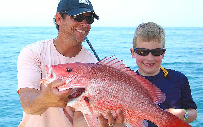 Capt. Terry David Lacoss, left, is pictured with Rodney Poland and a nice offshore red snapper. Amelia Island offers excellent bottom fishing at numerous close-to-shore fish havens. TERRY LACOSS/FOR THE NEWS-LEADER