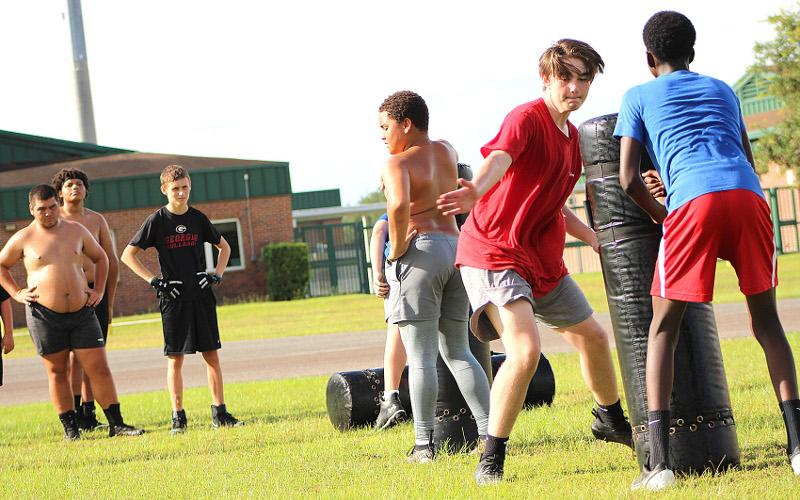 The Yulee Middle School football team held workouts Thursday morning, preparing for the 2020 season. BETH JONES/NEWS-LEADER
