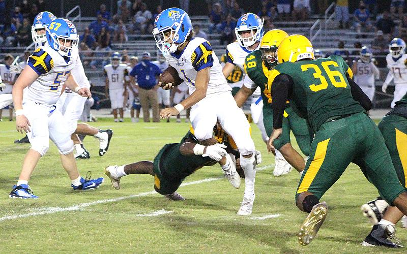 FBHS senior Khamari Barksdale heads for the end zone for the first of two touchdowns in the first half Friday night at Yulee. BETH JONES/NEWS-LEADER