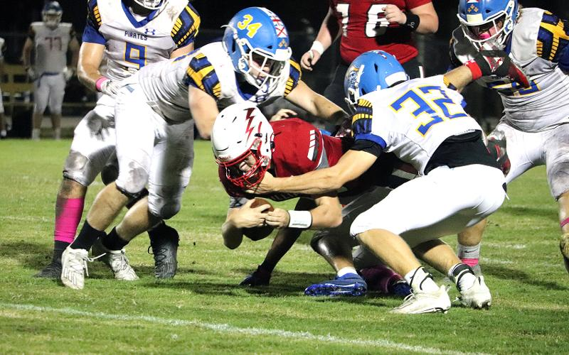 Brooks Rohe and A.J. West bring down a Hilliard Flash Friday night in Hilliard. KATHIE SCIULLO/COMMUNITY NEWSPAPERS INC.