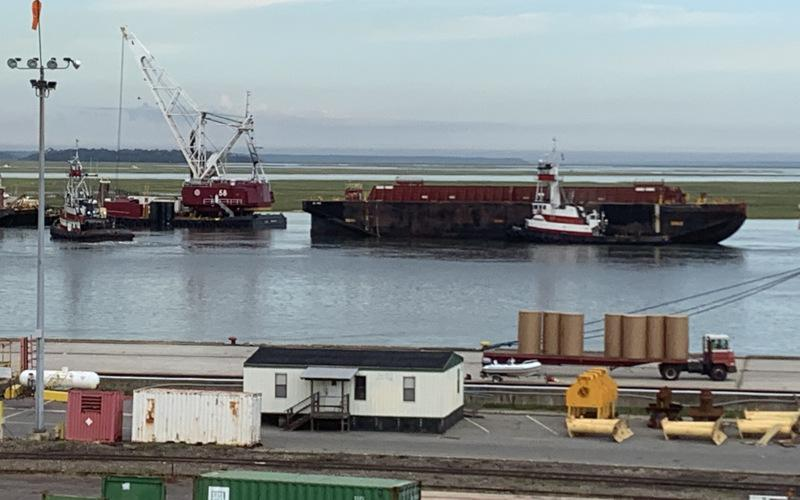 A clamshell bucket dredge and three ocean-going scows moved 400,000 cubic yards of material during a recent dredge of the Port of Fernandina, which will allow the port to receive ships with a draft of up to 40 feet. WORLDWIDE TERMINALS FERNANDINA
