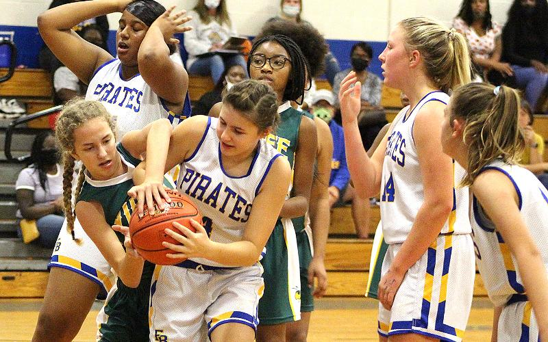 The Lady Pirates and Lady Hornets in action Monday at FBMS. BETH JONES/NEWS-LEADER