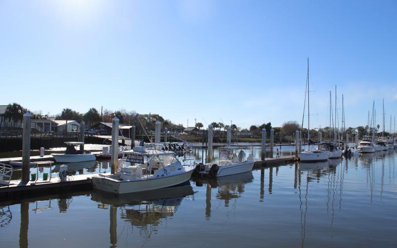 The new company charged with managing the Fernandina Harbor Marina has reversed course on increased prices for slips.