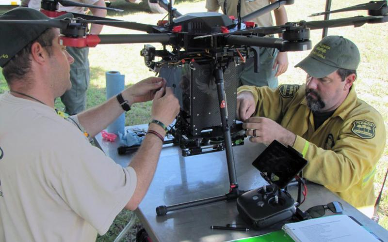 Florida Forest Service personnel prepare a drone for a test flight in the Withlacoochee State Forest recently. Photo courtesy of John Kern